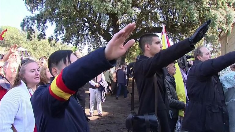 Outside the gates of the cemetery, supporters prayed and sang the anthem of the Spanish Falange as they gave fascist salutes