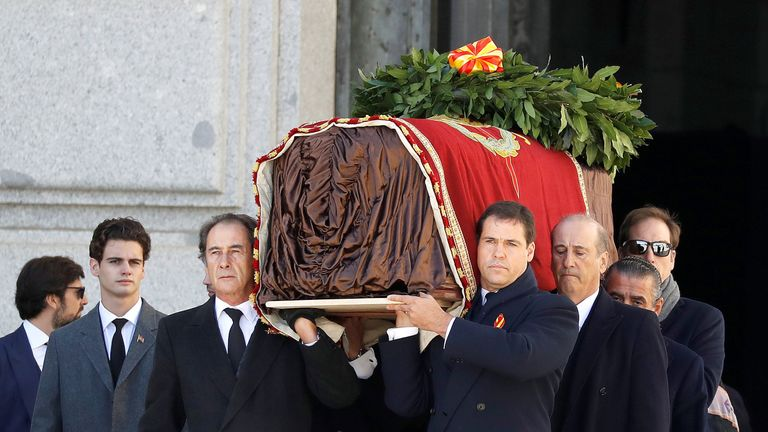 Family members carry the coffin of Spanish dictator Francisco Franco out of the basilica