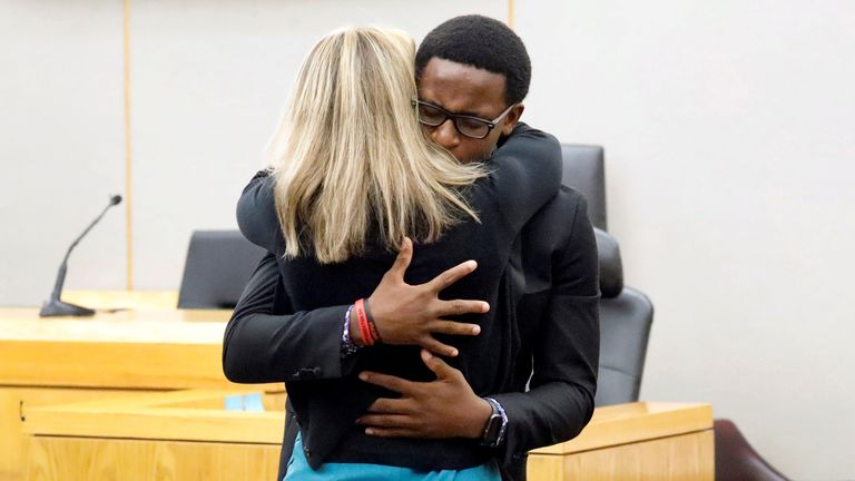 Botham Jean's younger brother Brandt Jean hugs former Dallas police officer Amber Guyger.  Tom Fox/Pool via REUTERS