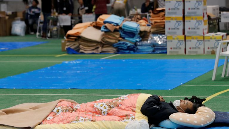 A man rests in an evacuation centre, in the aftermath of Typhoon Hagibis which caused severe floods, in Nagano Prefecture, Japan, October 14, 2019. REUTERS/Kim Kyung-Hoon
