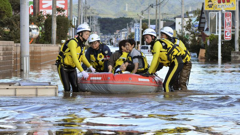 Local residents sit in a boat as they are rescued from a flooded residential area following Typhoon Hagibis in Iwaki, Fukushima prefecture, Japan, October 13, 2019. Pic: Kyodo
