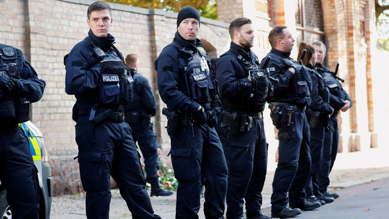 Police officers are lined up outside the synagogue in Halle