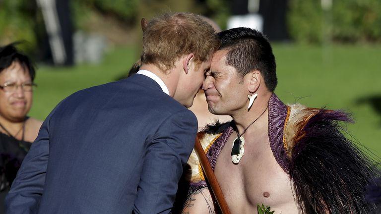Prince Harry receives a hongi (traditional Maori greeting) from a Maori warrior