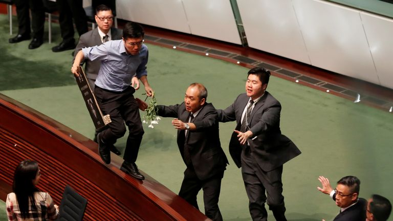 A pro-democracy politician tried to escape security guards in the LegCo chamber