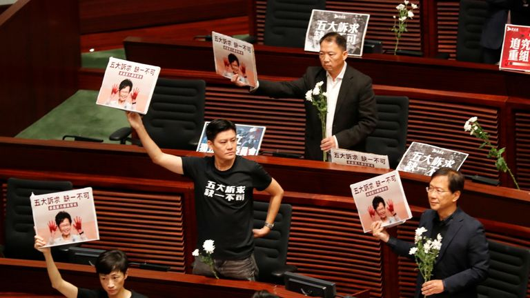 The 12 politicians wore t-shirts that said 'five demands, not one less'