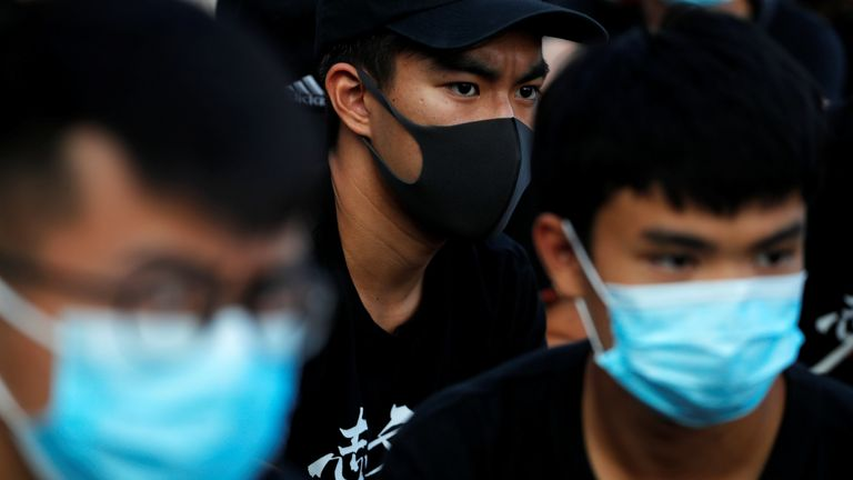 Hong Kong to 'ban masks at protests' under colonial law