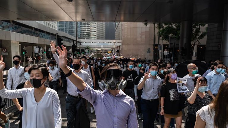 Protests over the mask ban are growing in the centre of the city