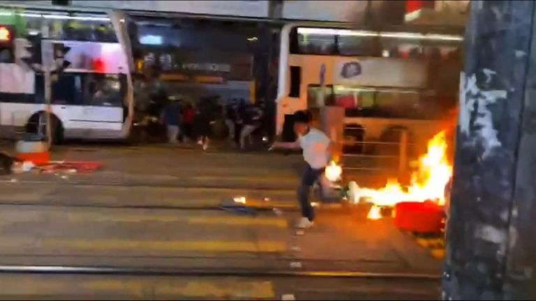 Hong Kong police officer running away from petrol bomb.