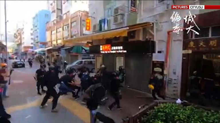 Video has emerged showing the moment a protester was shot during an altercation with police in Hong Kong