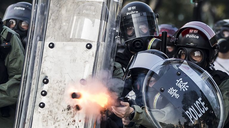 Riot police fire projectiles against protesters in the Sha Tin district of Hong Kong