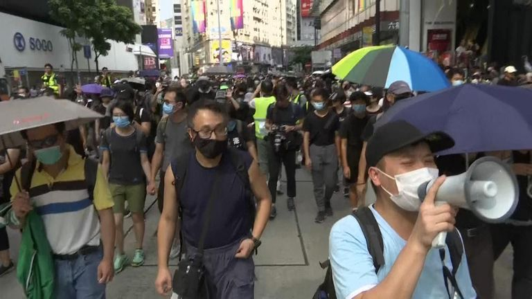 Hong Kong protesters walking through the street.