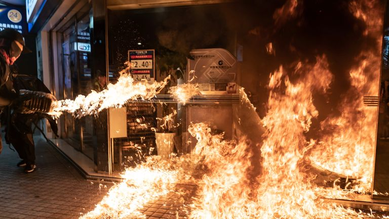 Pro-democracy protesters set a fire to a Chinese-owned bank