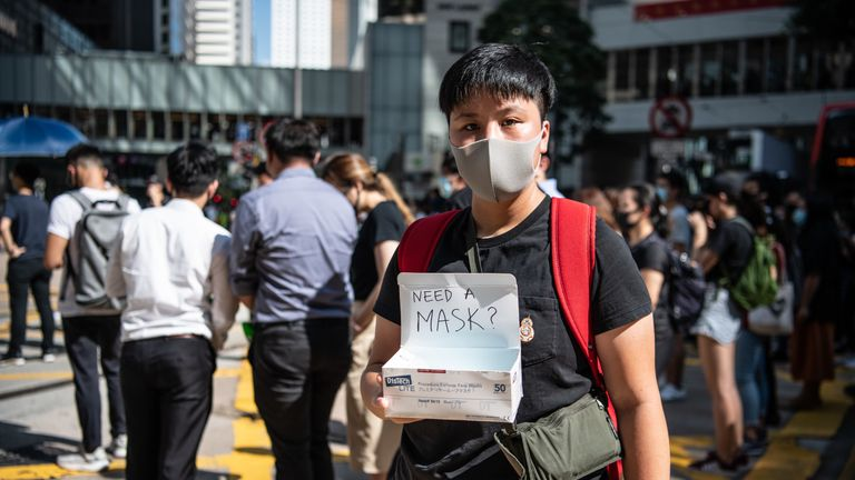 A protesters flouts the Hong Kong governmet's ban on masks in public