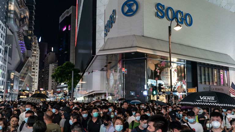 Pro-democracy protesters defied the ban on face masks as they marched in Causeway Bay