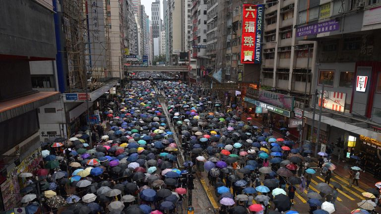 Thousands of people joined a protest march in the Causeway Bay shopping district on Sunday