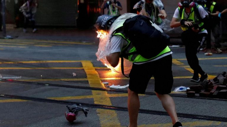 A journalist was hit by a molotov cocktail as protests in Hong Kong ended in violent clashes in several locations.