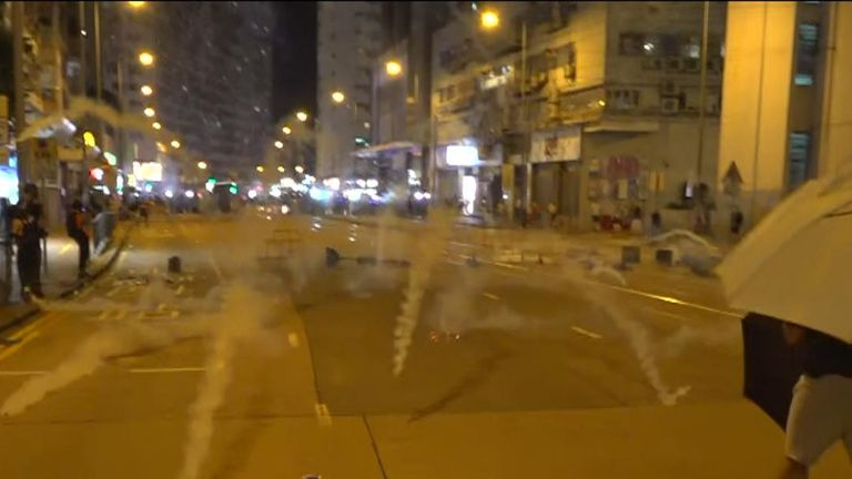 Volleys of tear gas rain down on protesters in Hong Kong