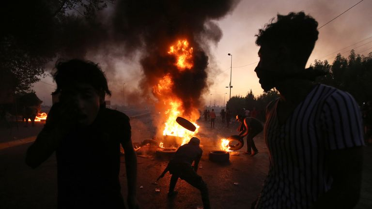 Iraqi protesters burn tyres during a protest on Saturday