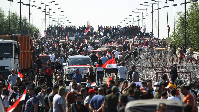 Iraqi protesters gather on the capital Baghdad's Al-Jumhuriyah Bridge on October 26, 2019, during an anti-government protest