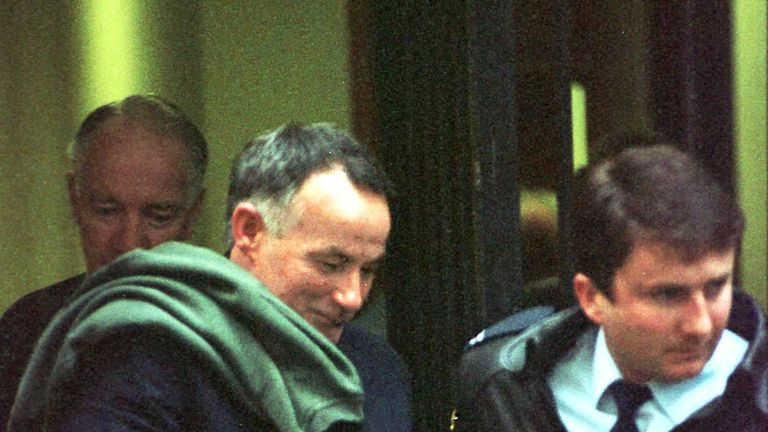 FILE PHOTO JULY96 - Australia's notorious serial killer Ivan Milat (left) is led from court during his trial in Sydney July 8, 1996. Milat, 51, serving a life sentence for the murder of seven backpackers