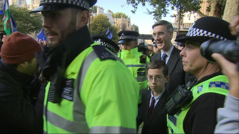 Jacob Rees-Mogg and his son are heckled outside Westminster