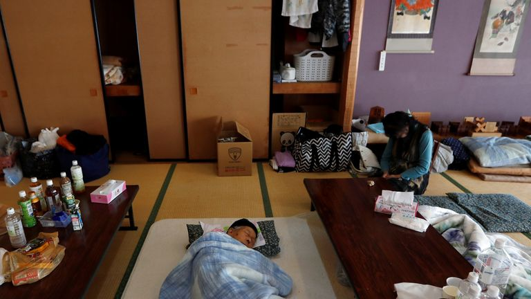 People rest in an evacuation centre