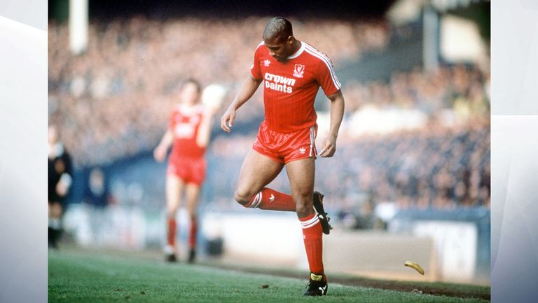 John Barnes backheels a banana that was thrown onto the pitch by a racist section of the crowd in 1988