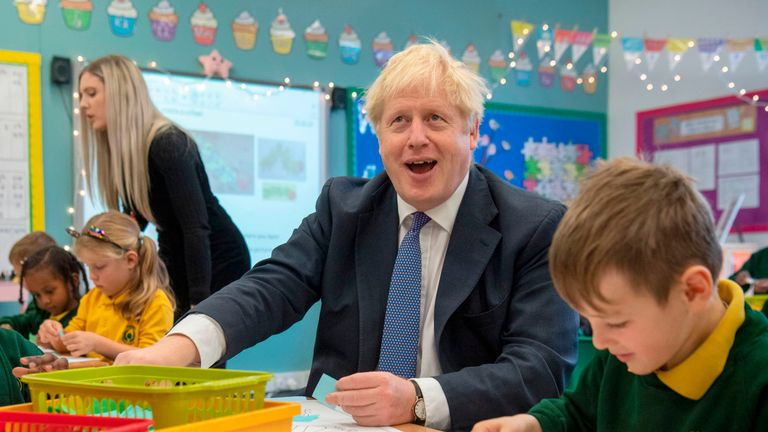 Britain's Prime Minister Boris Johnson speaks to pupils as he visits Middleton Primary School in Milton Keynes, southern England on October 25, 2019. - UK Prime Minister Boris Johnson on October 24 proposed settling the Brexit crisis through an early election on December 12 that could help Britain finally find a way out of the European Union. (Photo by Paul Grover / POOL / AFP) (Photo by PAUL GROVER/POOL/AFP via Getty Images)