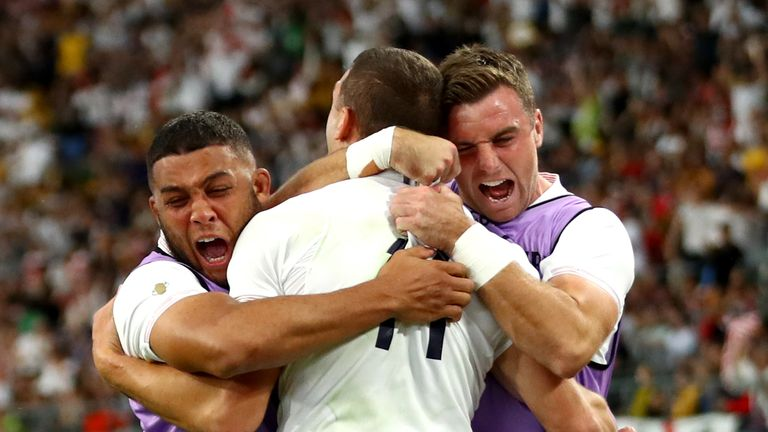 Jonny May of England celebrates with teammates after scoring his team's second try