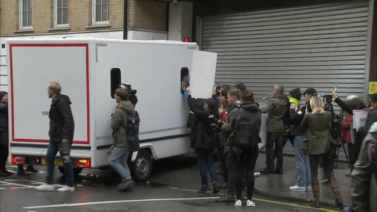 The van believed to be carrying Julian Assange to court
