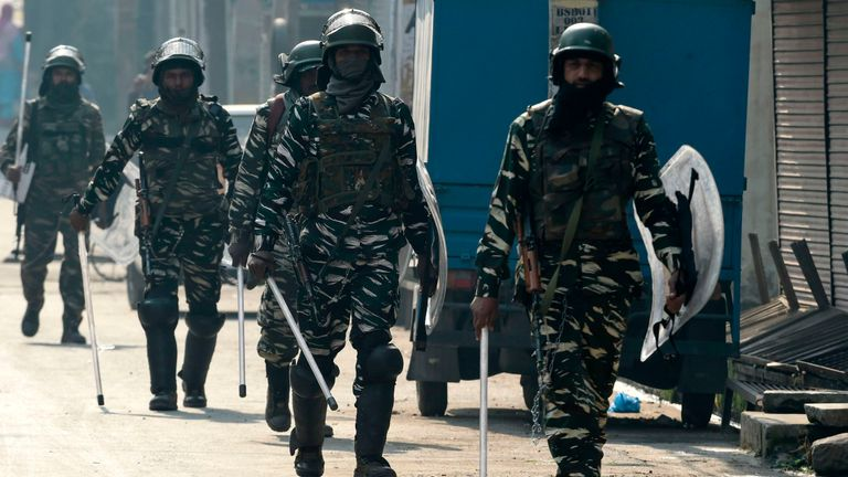 Indian paramilitary troopers patrol a street in Srinagar
