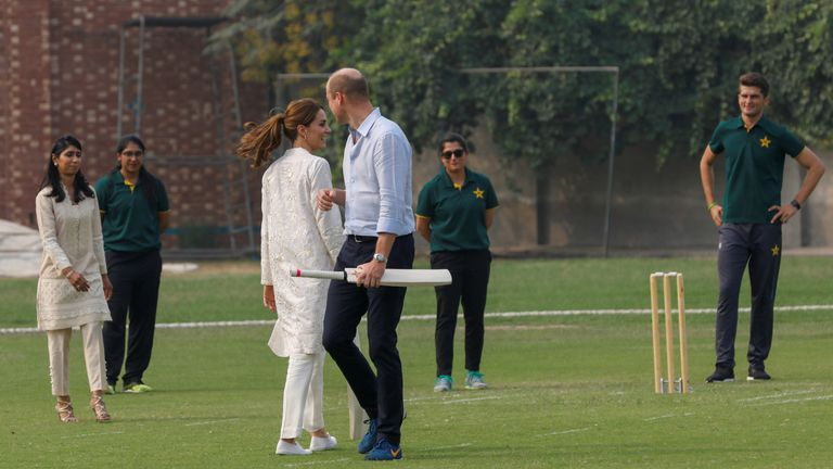 The royal couple take part in a cricket game in Lahore, Pakistan
