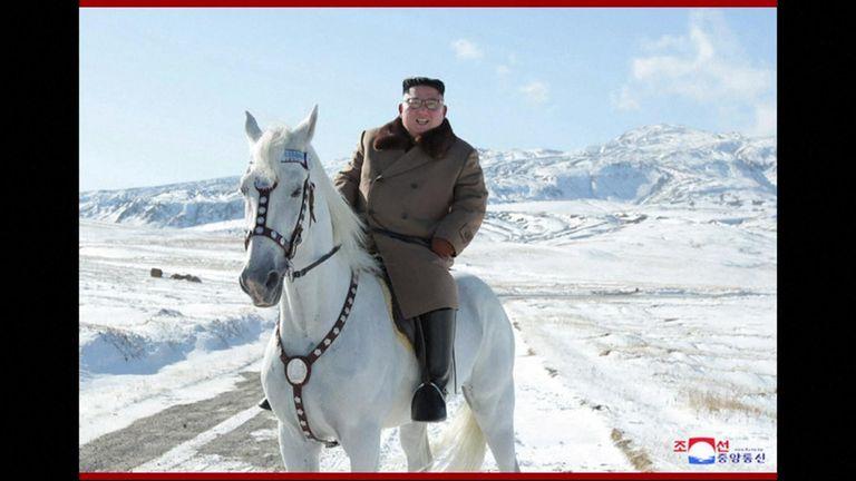Kim Jong Un riding a white horse on a sacred mountain
