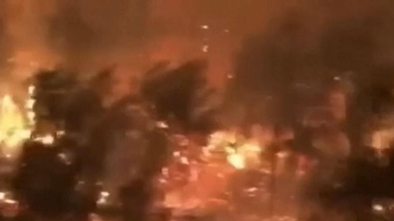 Firefighters take video of the Kincade fire in California
