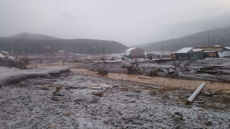 the scene of the accident following a dam failure at a gold mine in Krasnoyarsk Region
