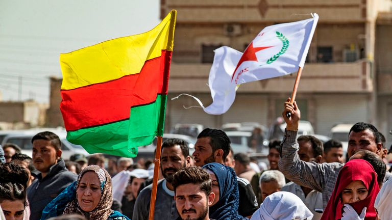 Syrian Kurds near the Turkish border demonstrate against Turkish threats