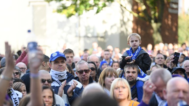 LEICESTER, ENGLAND - OCTOBER 19: Fans take part in a memorial walk as the anniversary of the death of former Leicester City chairman, Vichai Srivaddhanaprabha, approaches prior to the Premier League match between Leicester City and Burnley FC at The King Power Stadium on October 19, 2019 in Leicester, United Kingdom. (Photo by Michael Regan/Getty Images)