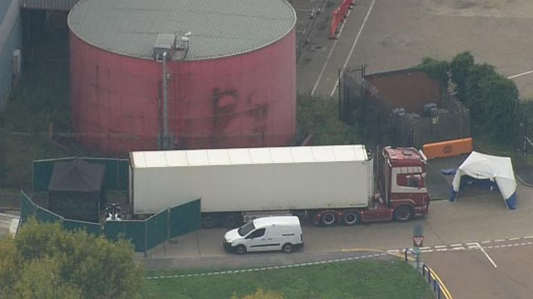 Lorry is surrounded by police and forensic team after discovery of 39 bodies inside it