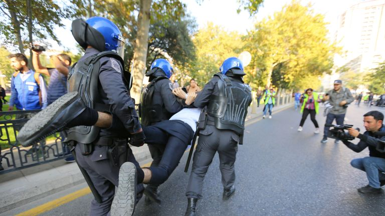 A man is detained during a rally in Baku, Azerbaijan