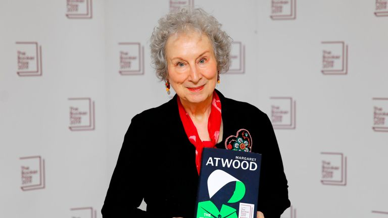 Canadian author Margaret Atwood poses with her book The Testaments during the photo call for the authors shortlisted for the 2019 Booker Prize for Fiction