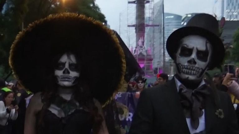 Mexicans dressed as elegant skeletons took to the streets of their capital on Saturday as the country's Day of the Dead festivities extend in scope and popularity.