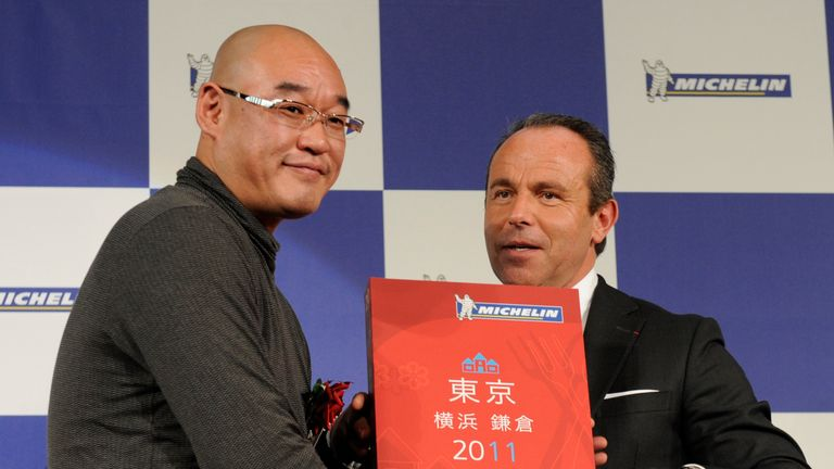 Mitsuhiro Araki (left) when he got three stars for the first time in 2010