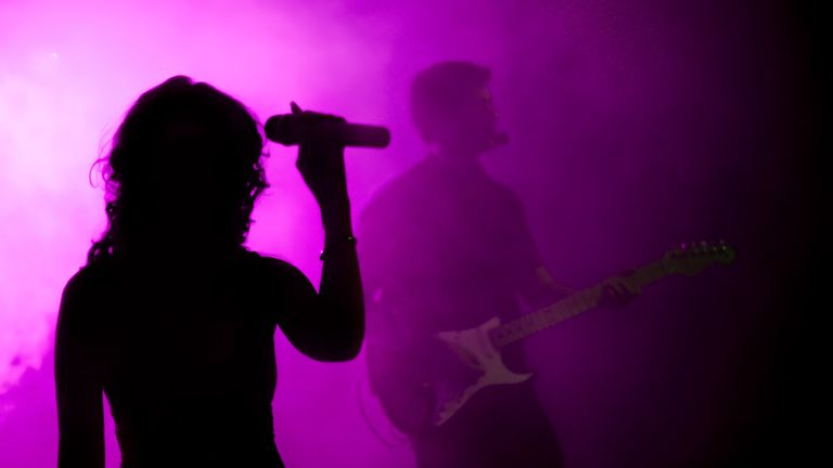 Female singer and guitarist silhouette