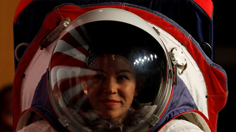 NASA unveiled two new spacesuits designed for the space agency's Artemis moon mission to take Americans back to the moon by 2024