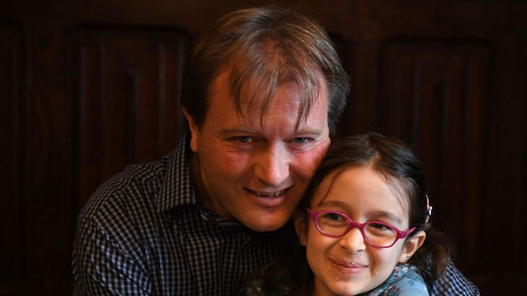 Richard Ratcliffe, husband of British-Iranian aid worker Nazanin Zaghari-Ratcliffe jailed in Tehran since 2016, holds his daughter Gabriella during a news conference