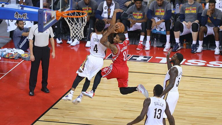 The Houston Rockets playing against the New Orleans Pelicans in China
