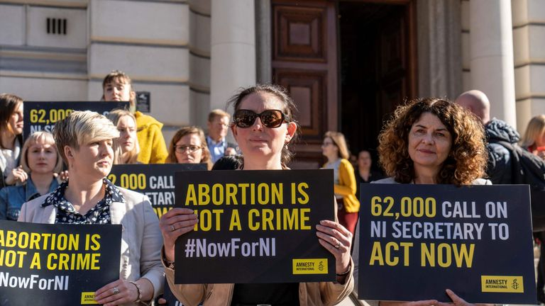 Demonstrators hold placards as they take part in a protest calling for change to Northern Ireland's abortion laws, during a protest in central London on February 26, 2019. (Photo by Niklas HALLE'N / AFP) (Photo credit should read NIKLAS HALLE'N/AFP/Getty Images)