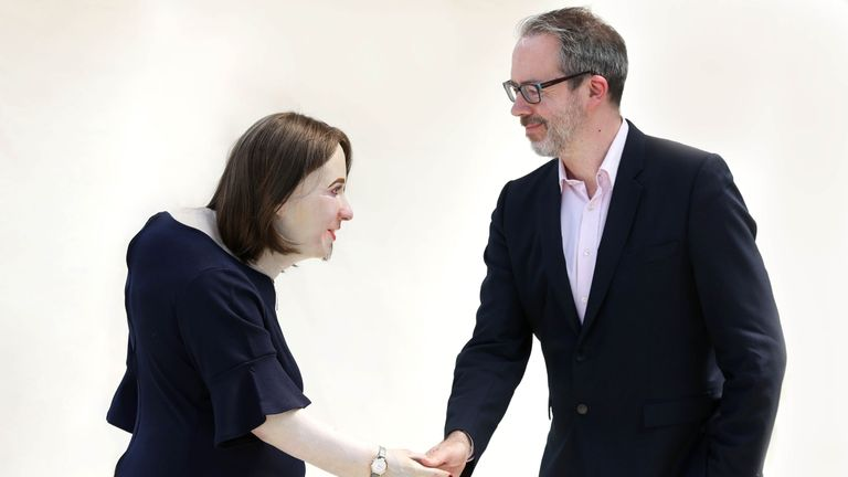 Behavioural Futurist William Higham unveils a life-sized model named 'Emma', which has been created by Fellowes, to illustrate how office workers may look in 20 year's time