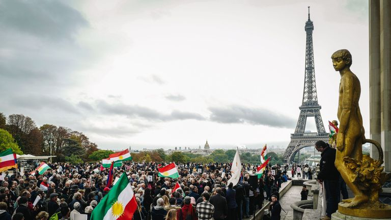 People take part in a demonstration at the Human Rights plaza in Paris on October 12, 2019, to support Kurdish militants as Turkey kept up its assault on Kurdish-held border towns in northeastern Syria today, on the fourth day of an offensive that is drawing growing international condemnation, even from Washington