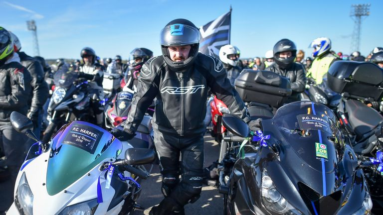 A tribute dedicated to PC Andrew Harper sits on the windshield of a motorbike